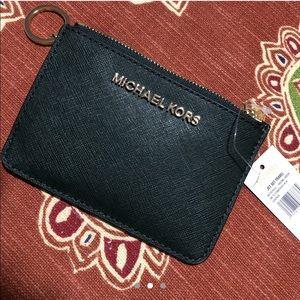Michael Kors coin pouch.
